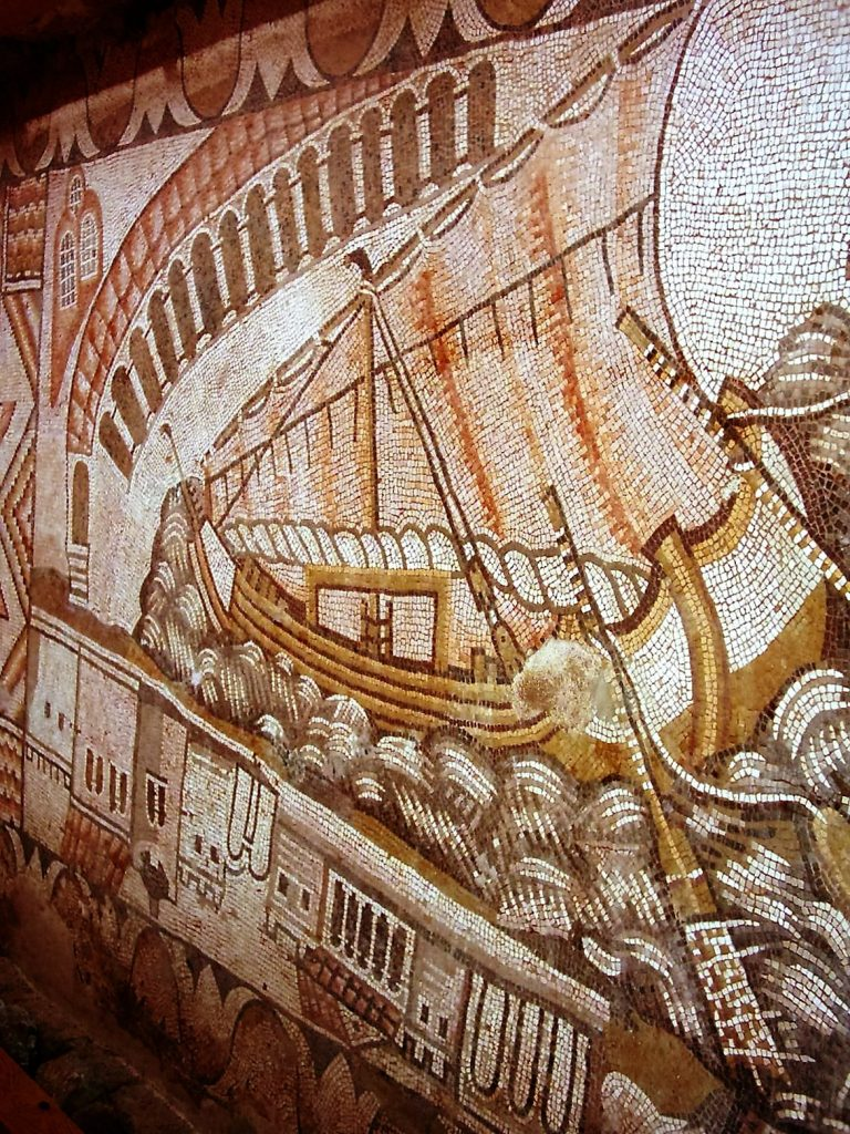 Kelenderis 5th c. AD mosaïc (Turkey) dicovered by Levent Zoroglu in 1986, showing a partially brailed sail with the top yard pointing down to the bow, making the rig look like a lateen rig.