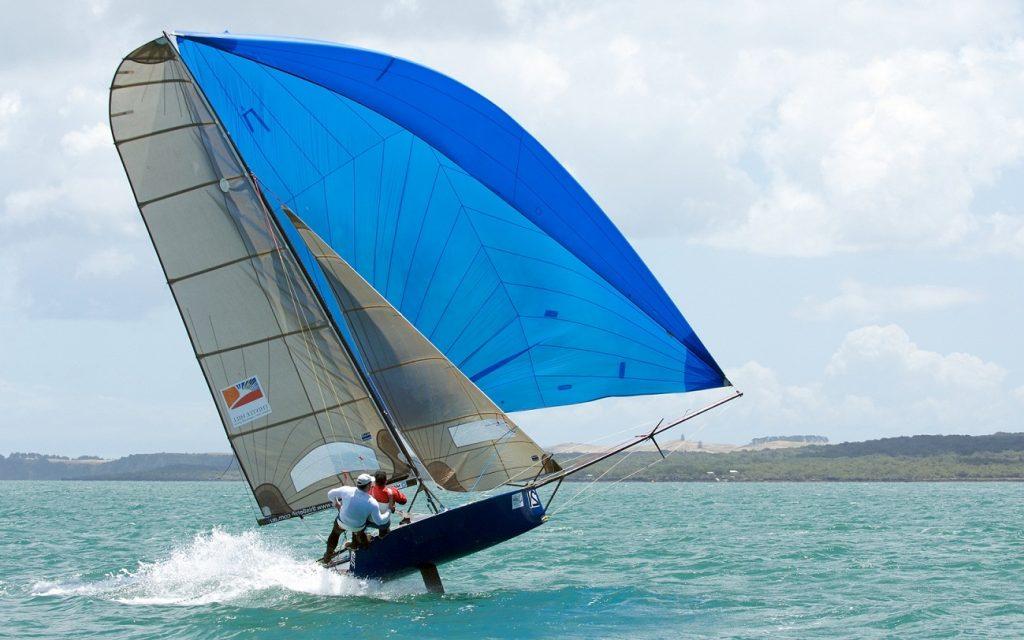 Modern sailing boat under spinnaker at beam reach … rather sportive!