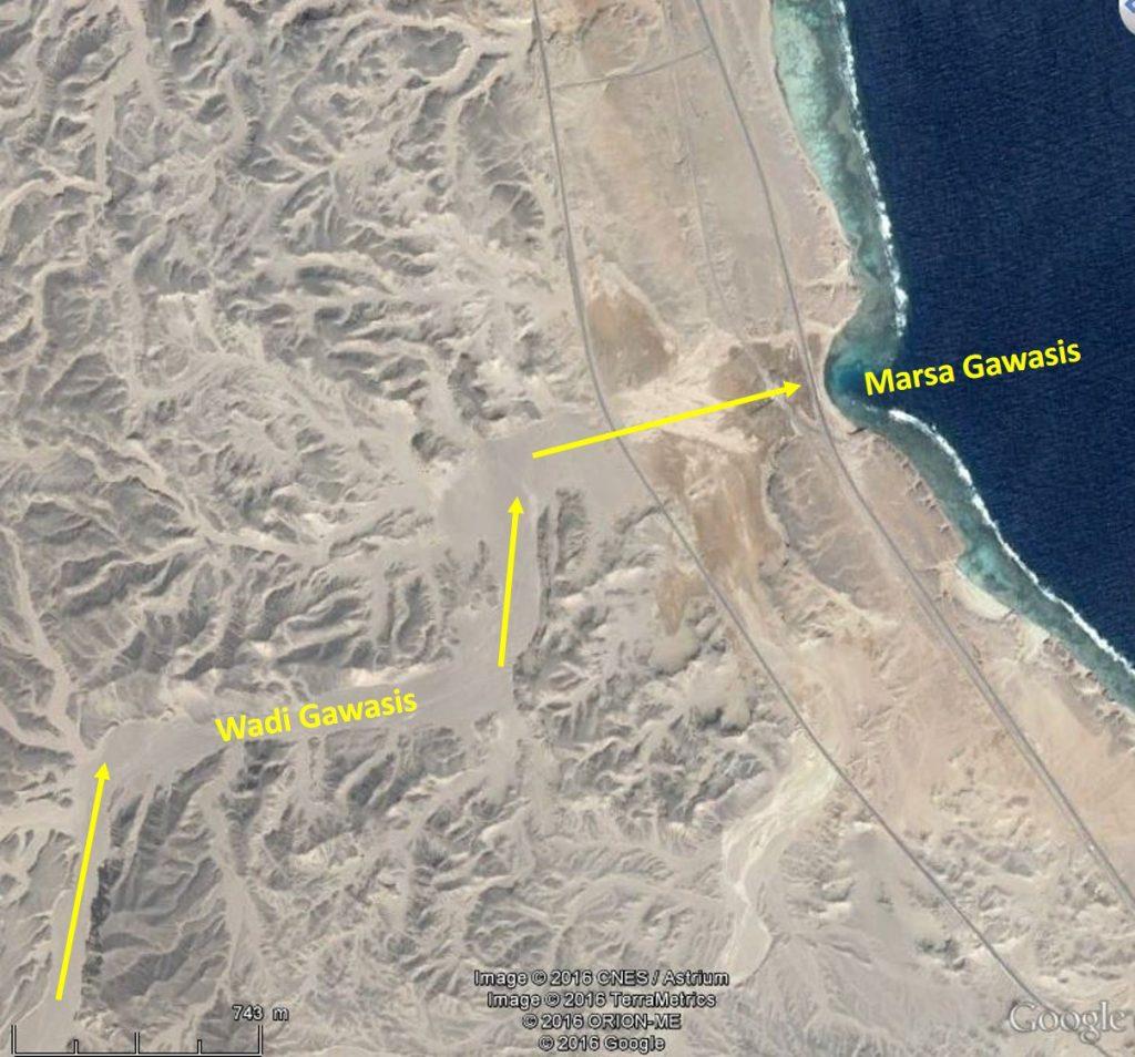 Marsa Gawasis cove as an interruption of the coral reef, and wadi Gawasis flowing into the sea.